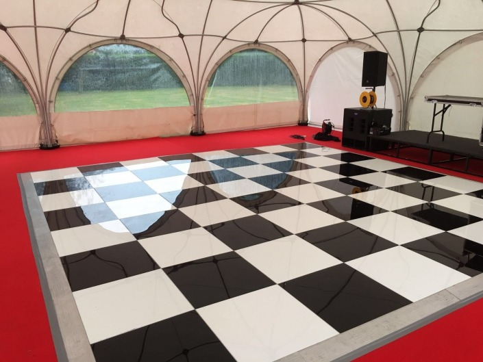 black and white chequered dancefloor wedding private marquee