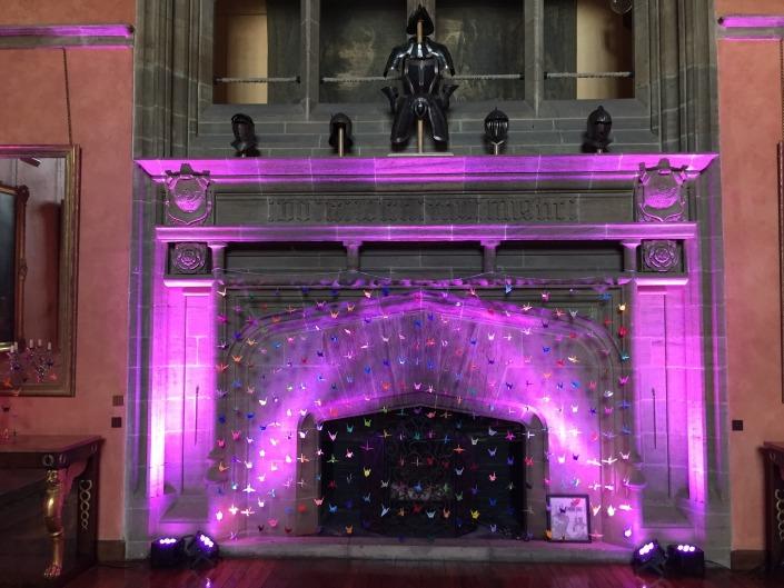 purple uplighters on fireplace at bucks hall