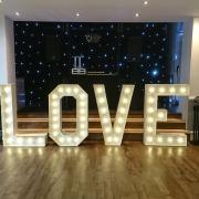 4ft LOVE and black starcloth at hilton avisford