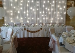 top table light up twinkle backdrop at hilton avisford ballroom 1