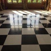 black and white dancefloor at cowdray house facing bay windows