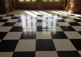 black and white dancefloor at cowdray house facing bay windows