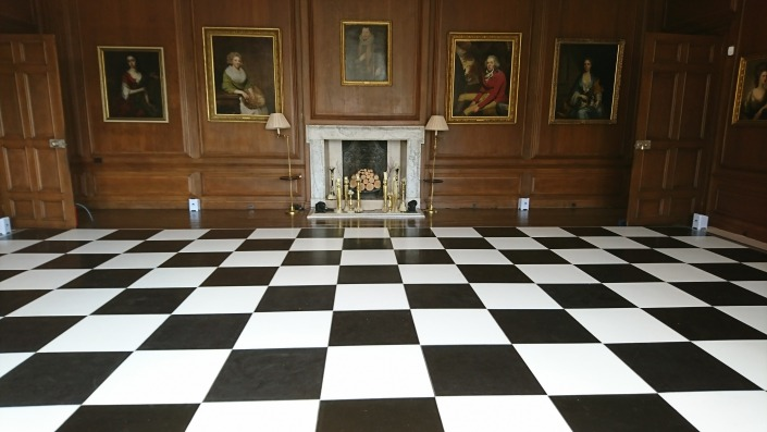 black and white dancefloor at cowdray house in the dinign room with wireless uplighters